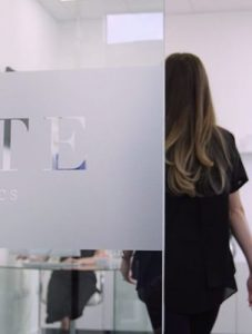 Female Walking into a Consultation Room